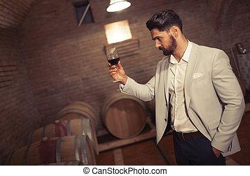 Wine maker testing wines