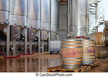 Wine manufacturing. Modern winery tanks.