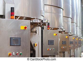 Wine manufacturing. Modern winery tanks.