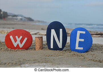 Concept of wine with stones and a cork composition on the beach