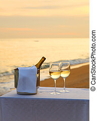 Wine on a table at sunset