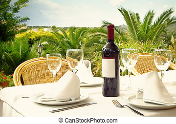 Wine on Holiday - Bottle of wine on restaurant table