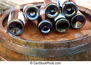Wine over wood barrel - bottles of wine lying over wooden...