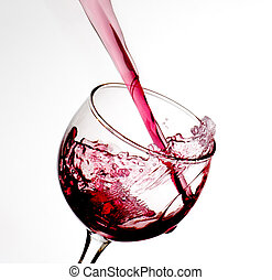 Wine pour - The action of wine pouring into a glass is...