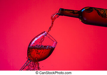 Wine Pouring Out of Bottle On The Right Hand Side to Whineglass with Colorful Liquid, Droplets and Drops.