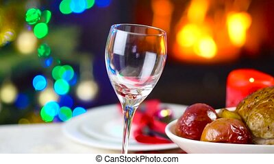 wine pouring to glass on table in front of fireplace