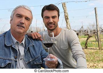 Wine producers in vineyard