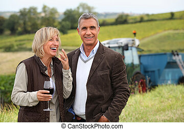 wine producers laughing in the vines