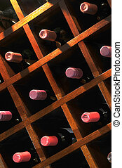 Wine Rack - A wall mounted wine rack in cellar, with necks...