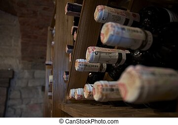 wine bottles laying in wooden rack