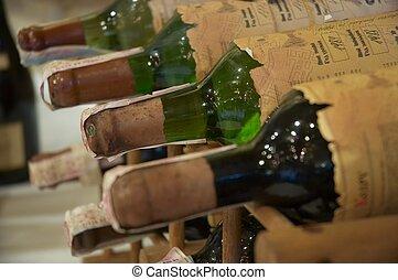 wine rack - wine bottles laying in wooden rack