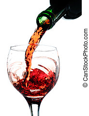 Wine - Red wine pouring in glass. Isolated over white....