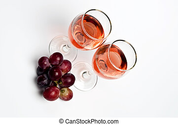Wine - Rose wine glass and grapes close up