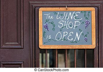 Open sign on wine shop door in St Augustine, Florida