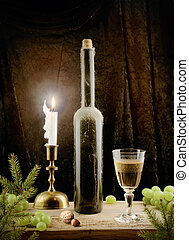 Wine still life with candle in vintage style