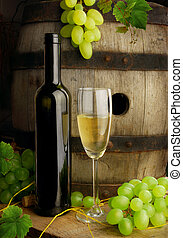 Wine still life with grapes and barrel