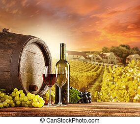 Wine still life with vineyard on backgorund