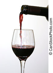 Wine - Pouring red wine.
