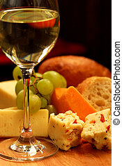 Wine tasting - Glass of white wine and assorted cheeses for...