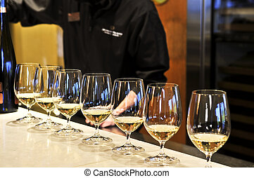 Wine tasting glasses - Row of white wine glasses in winery ...