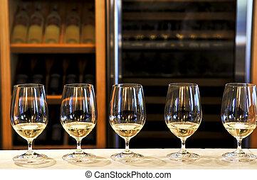Wine tasting glasses - Row of white wine glasses in winery...