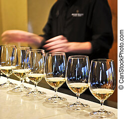 Wine tasting glasses - Row of white wine glasses in winery ...