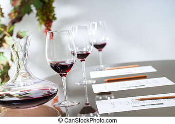 Wine tasting table set with decanter and glasses. - Close up...