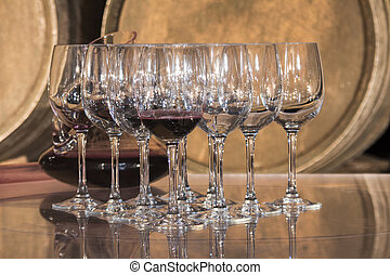Wine tasting - Wineglasses in a Cellar, barrel as background