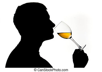 Wine testing - A man in silhouette smelling white wine
