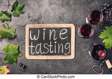 Wine testing concept on dark background, copyspace, flat lay