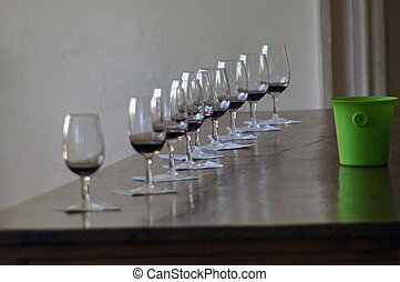wine testing - several glasses with red wine on a table