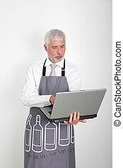 Wine waiter using laptop computer