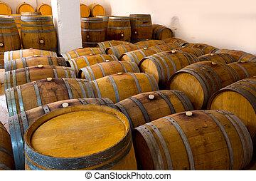 wine wooden oak barrels in winery