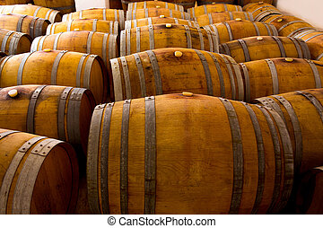 wine wooden oak barrels in winery