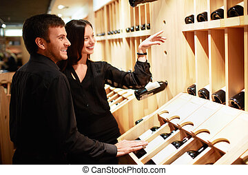 Young couple chooses the wine