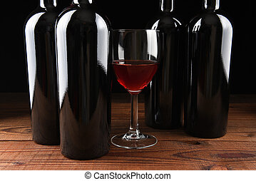 Wineglass and Four Bottles