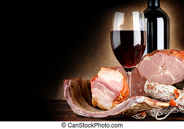 Wineglass and meat - Wine and meat on an old canvas
