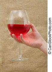 Wineglass on hand