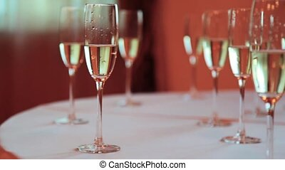 Wineglass with champagne on the table