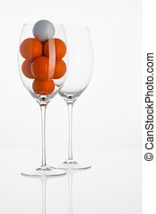Wineglass with golf balls
