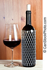 wineglass with red wine and bottle of red wine