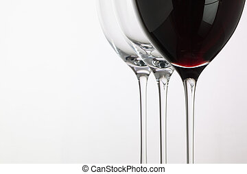 Wineglass with red wine on a white background