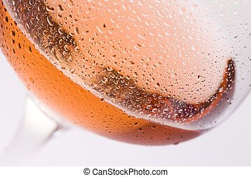 wineglass with rose wine