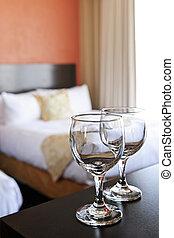 Wineglasses in hotel room - Romantic bedroom with wine ...