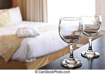 Wineglasses in hotel room - Romantic bedroom with wine...