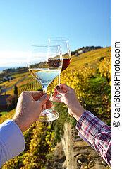 Wineglasses in the hands. Lavaux. Switzerland