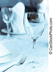 Wineglasses on the arranged table