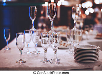 Wineglasses with plates on table service at banquet