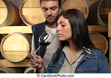 Winegrowers tasting a wine