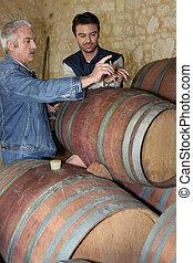 Winegrowers testing their wine
